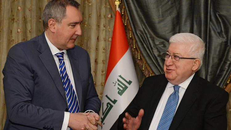 نائب رئيس الوزراء الروسي دميتري روغوزين والرئيس العراقي فؤاد معصوم