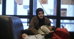 لاجئة سورية وأطفالها في السويد