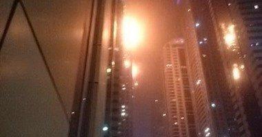 """صورة إخماد حريق البرج السكنى فى """"مارينا دبى"""""""