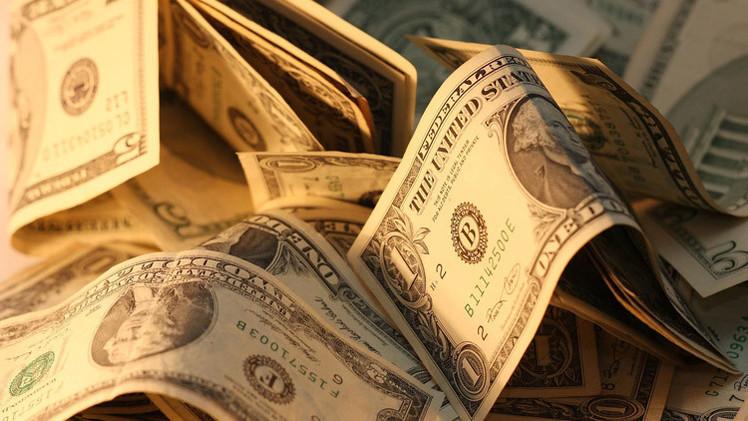 صورة صحيفة: الصين قادرة على تحطيم الدولار بـ 30 ألف طن من الذهب