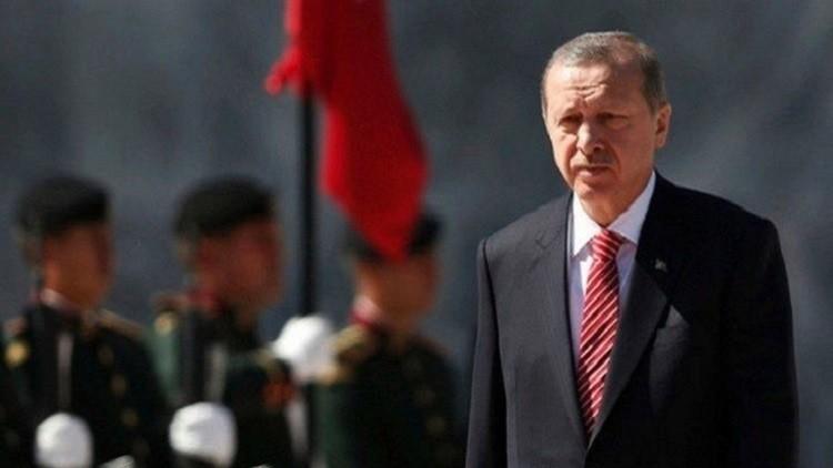 صورة أردوغان: تركيا لا تنوي سحب قواتها من العراق.. والعبادي يرد