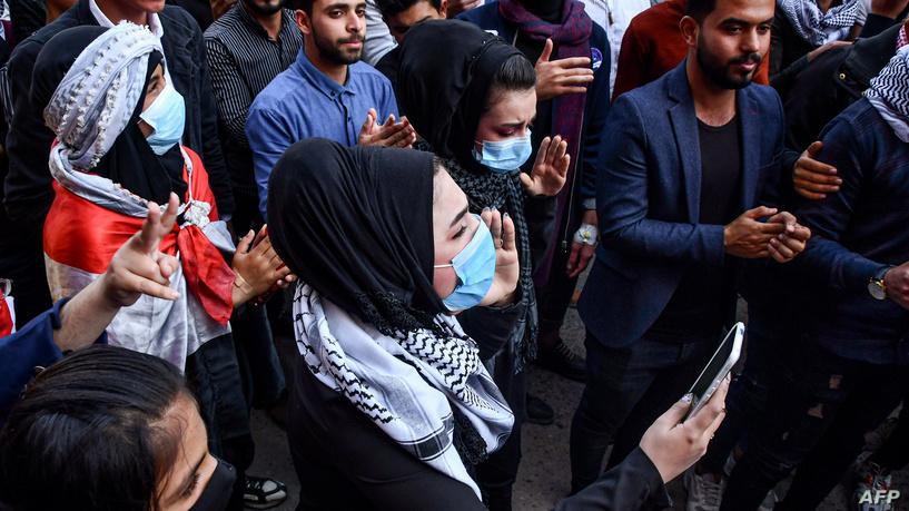 صورة انفجار دراجة مفخخة قرب خيام متظاهرين في الناصرية…11 جريحا