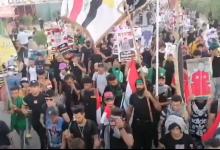 صورة الاعتداء على المتظاهرين في حرم الامام الحسين